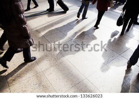traveling people walking at the railway station - stock photo