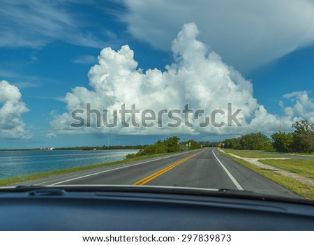 traveling the roads in a car enjoying a beautiful view - stock photo