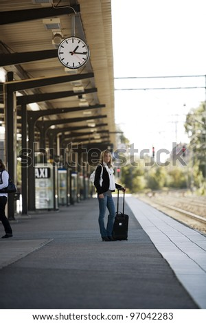 Traveling Woman at the Train Station - stock photo