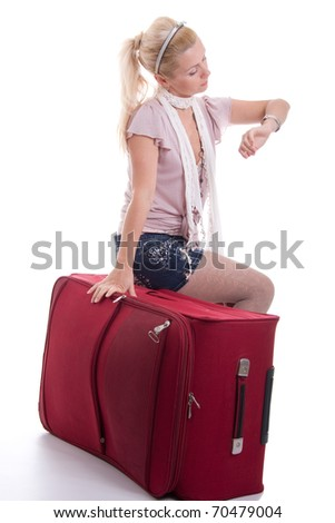 Traveling young woman with luggage on white background - stock photo