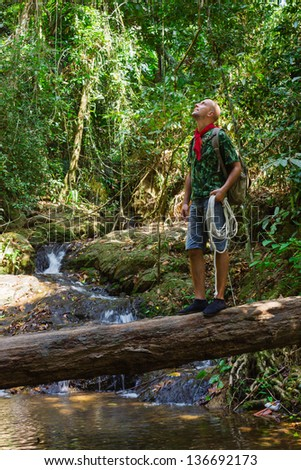 Travelling man in tropical jungles of South East Asia - stock photo