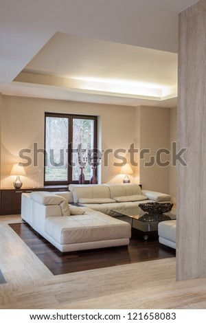 Travertine house: Comfortable sofa in modern interior - stock photo