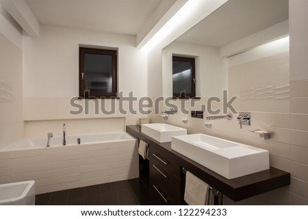 Travertine house - Cream and brown color in bathroom - stock photo