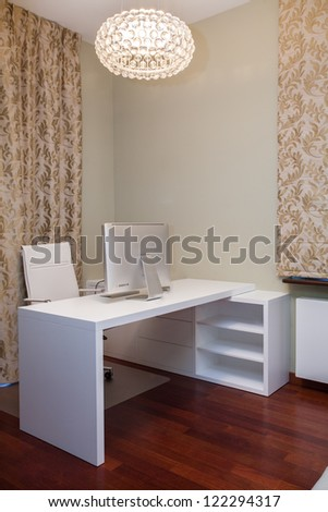 Travertine house - golden home office with white furniture - stock photo