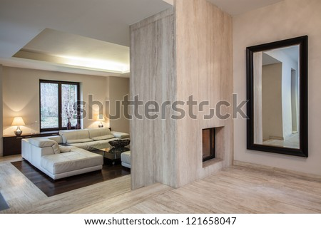 Travertine house: View of hallway and entrance to living room - stock photo
