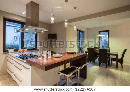 Travertine house - view on  kitchen and dining room - stock photo