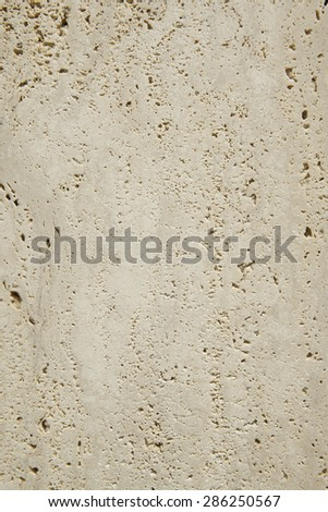 Travertine marble surface detail in vertical format. Indoor - stock photo