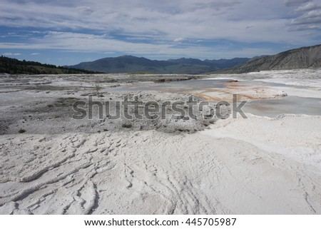 Travertine terraces at Mammoth Hot Springs, Yellowstone - stock photo