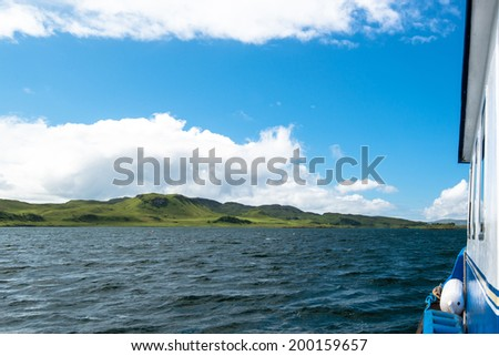 Trawler fishing boat working in open waters along the coast of Oban, Scotland - stock photo