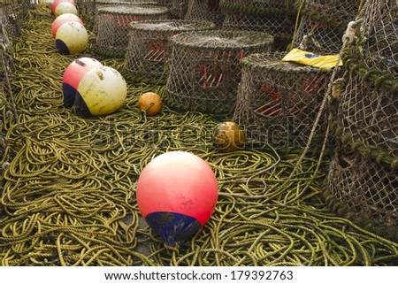 Trawler fishing nets, ropes and equipment set out on Mudeford Quay, Christchurch, Dorset, England, United Kingdom. - stock photo