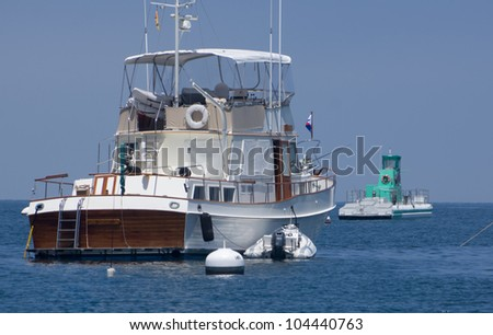 Trawler style yacht moored with dinghy at Santa Catalina Island in California - stock photo
