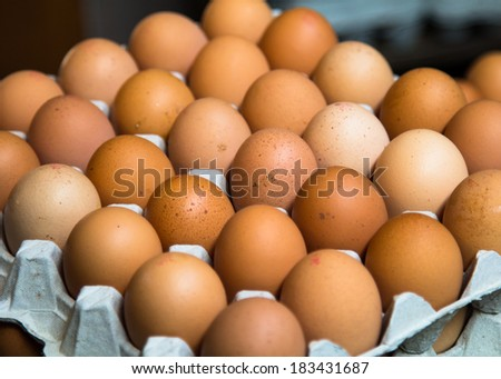 Tray of eggs on display at a market - stock photo