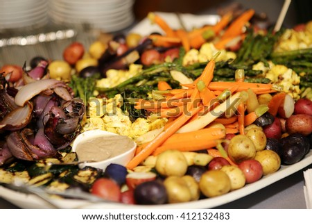 Tray of grilled vegetables for a party. - stock photo