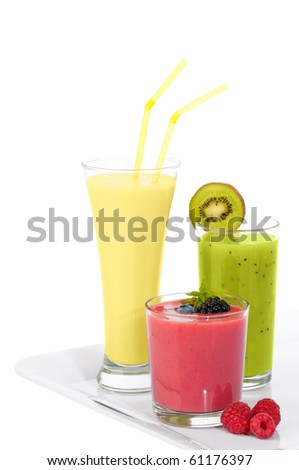 Tray of smoothie juice drinks with kiwi, banana and berries on a white background - stock photo