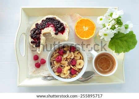 Tray with cereals, bread with jam and cup of coffee - stock photo