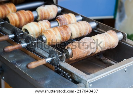 Trdeln�k, a traditional Hungarian cake and sweet pastry, here also a tradition in Prague - stock photo