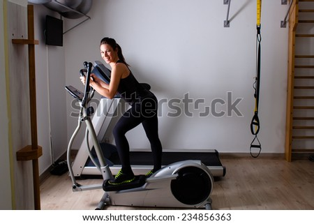 treadmill exercise at home gym - stock photo