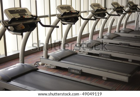 Treadmills in the health club - stock photo