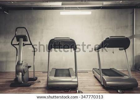 Treadmills set in gym interior - stock photo