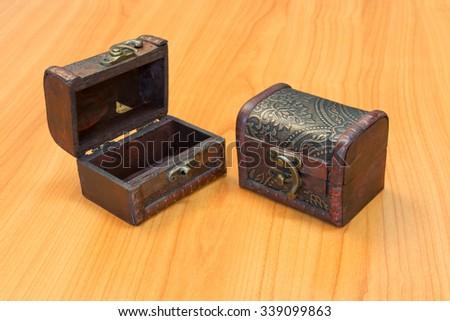 Treasure chest and have a wood floor in the background - stock photo