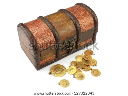 Treasure chest filled with gold - stock photo