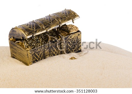 Treasure chest from pirates with gold coins and nuggets  - stock photo