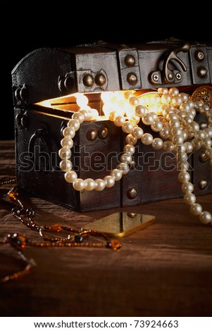 treasure chest with gold and pearls - stock photo
