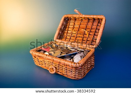 Treasure concept - money and credit cards in the box lighted brightly - stock photo