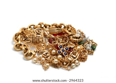 Treasure with lots of pieces jewelry  in gold - stock photo
