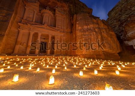 Treasury (Khasneh) in Petra, Jordan at night. Petra by Night in the light of 1,800 candles. - stock photo