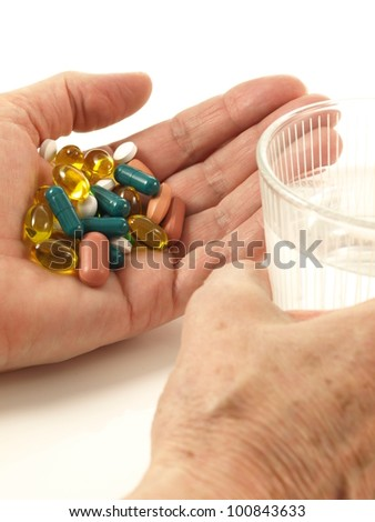 Treatment of an old person on isolated background - stock photo