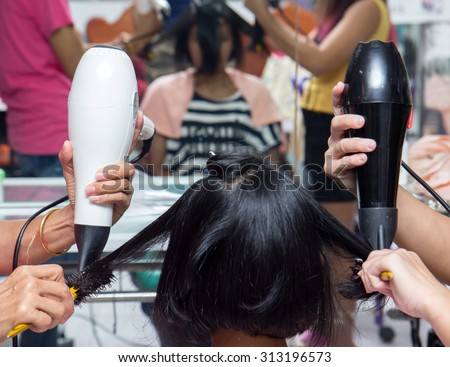 treatment of hair in a hairdressing salon - stock photo