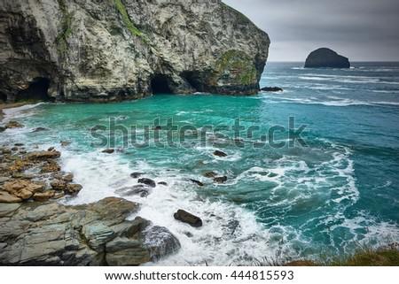 Trebarwith strand and gull rock, Cornwall, England. - stock photo