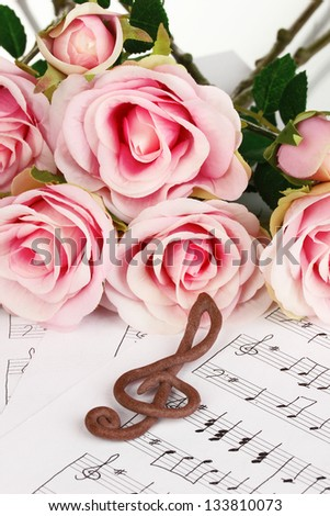 Treble clef and roses on musical background - stock photo