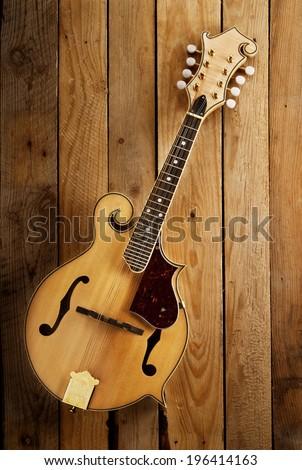 treditional bluegrass mandolin wooden slats background - stock photo