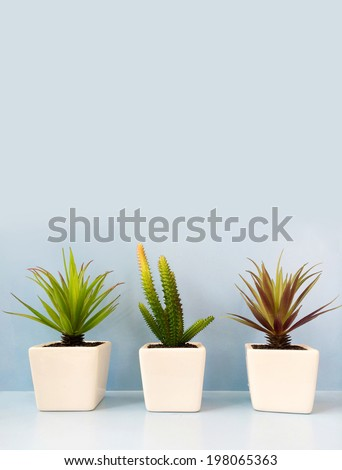 Tree artificial plant in the vase for decoration shelf - stock photo