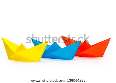 Tree colored paper ships on a white background - stock photo