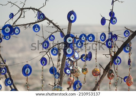 Tree covered in 'Nazar' charms in Cappadocia, Turkey - stock photo