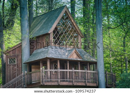 Tree House in the woods - stock photo