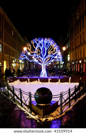 Tree of lights in New Year's eve in city - stock photo