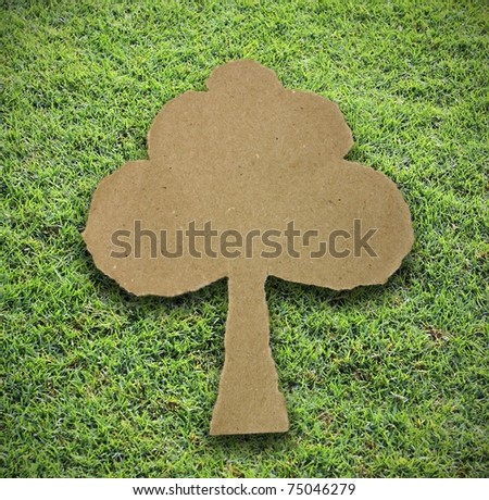 tree paper attach on grass background - stock photo