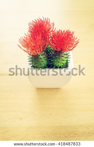 Tree pots decoration on wooden table, Vintage tone - stock photo