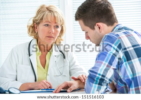 treenager suffering with depression in a conversation with a therapist - stock photo