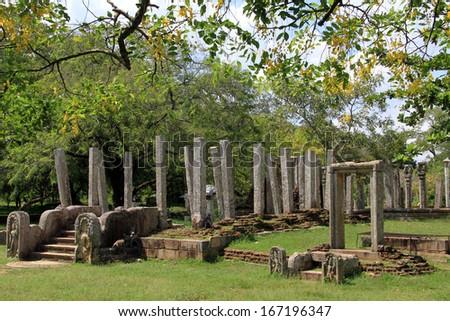 Trees and ruins of buddhist temple in Anuradhapura, Sri Lanka - stock photo