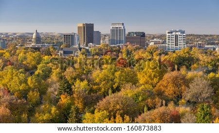 Trees in full autumn color and the skyline of Boise Idaho - stock photo