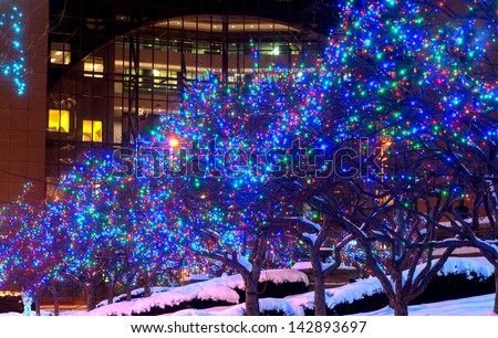 Trees lighted in blue lights for Christmas in downtown Cleveland Ohio - stock photo