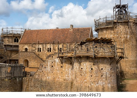 TREIGNY,FRANCE - MARCH 27 2016 : The future castle of Guedelon is an entirely new construction based on the  architectural canons of the 13th century. Begun in 1996, the project should end in 2025. - stock photo