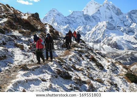 trekker from everest trek route in nepal - stock photo