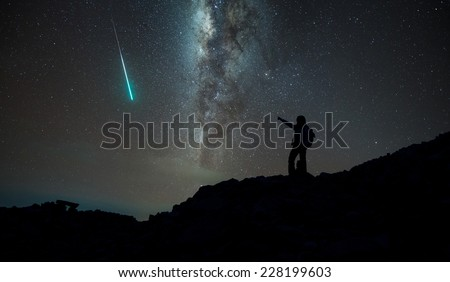 Trekker with milky way and shooting star in background, Annapurna region, Nepal - stock photo