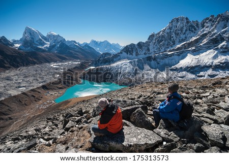 Trekkers admiring stunning views of himalayas from Gokyo ri, Nepal - stock photo